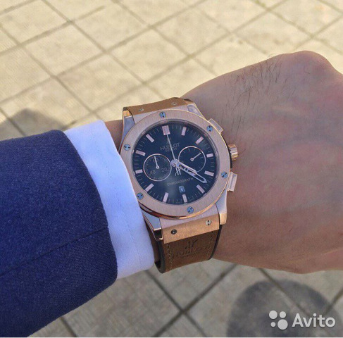 Коричневые мужские часы для